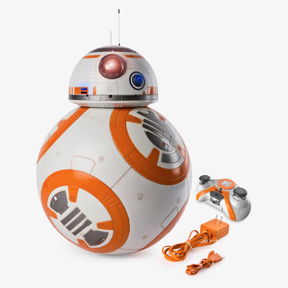 """<p>""""The loyal astromech droid will delight collectors and kids with his impressive size <span>— </span>over 16 inches tall <span>— </span>and built-in voice recognition. Set Hero Droid BB-8 to 'Follow Me' mode and it will roll beside fans just as loyally as it would follow Rey or Poe! Additionally, users can control BB-8 with the enhanced two-stick remote via RC control."""" $229.99 (Photo: Spin Master) </p>"""