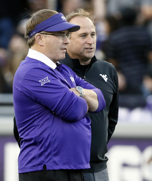 FILE - In this Oct 29, 2015 file photo, TCU head coach Gary Patterson, left, and West Virginia head coach Dana Holgorsen, right, talk on the field before an NCAA college football game in Fort Worth, Texas. Patterson and West Virginia coach Dana Holgorsen have a mutual respect for each other. Their teams joined the Big 12 together in 2012. Holgorsen always pays compliments to TCU's defense when the teams meet and, injuries aside, Saturday will be no different when TCU (4-5, 2-4 Big 12) plays the Mountaineers (7-1, 5-1, No. 9 CFP). West Virginia plays TCU on Saturday, Nov. 10, 2018. (AP Photo/Tony Gutierrez, File)