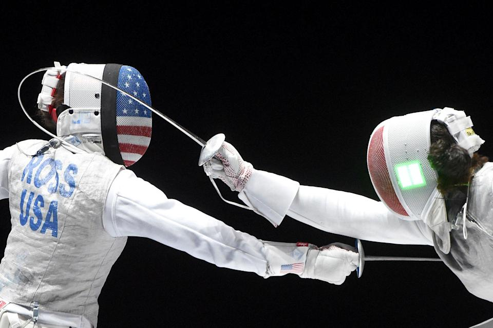 """Nicole Ross, left, of the US fights against Ysaora Thibus of France during the third place match for the women's foil team competition of the FIE World Fencing Championships in Budapest, on July 22, 2019.<span class=""""copyright"""">Balazs Czagany—MTI/AP</span>"""