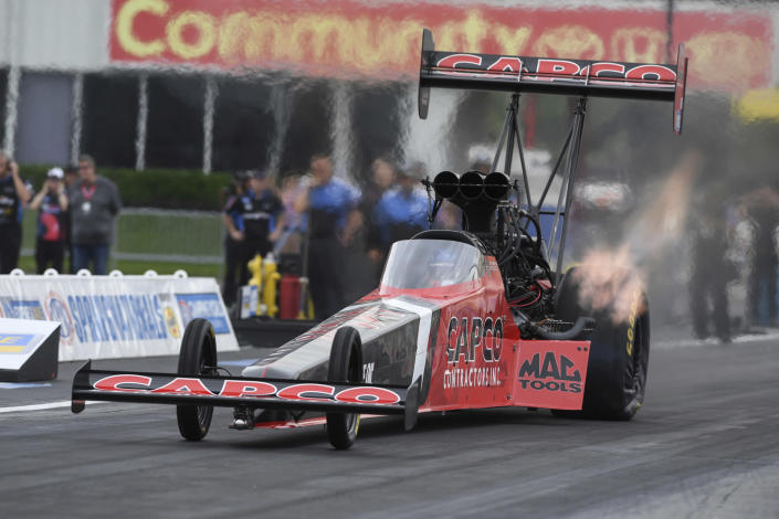 In this photo provided by the NHRA, Texas native Steve Torrence pedals his Top Fuel dragster to secure his first win at Houston Raceway Park in Baytown, Texas, Monday, May 24, 2021, when he defeated Doug Kalitta in the final round of the Mopar Express Lane NHRA SpringNationals. (Jerry Foss/NHRA via AP)