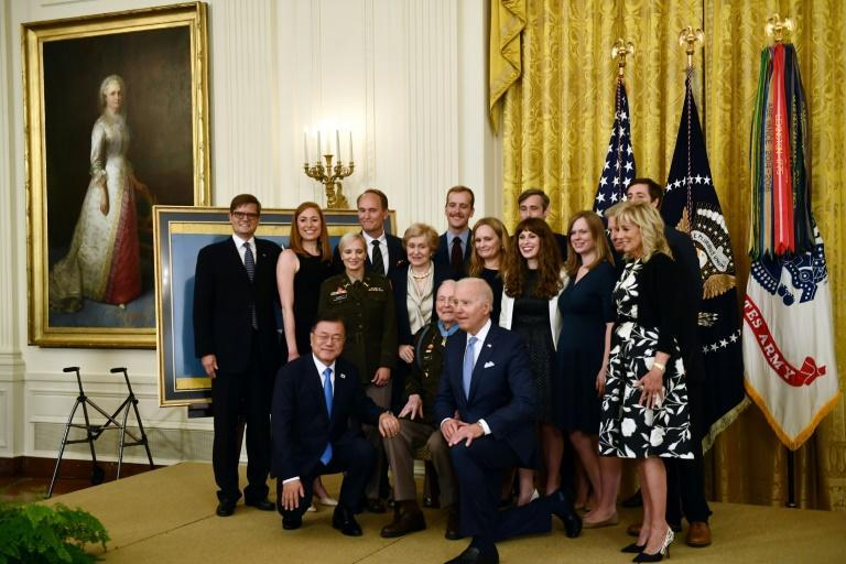 South Korea's President Moon Jae-in and US President Joe Biden posed with retired colonel Ralph Puckett after his Medal of Honor ceremony