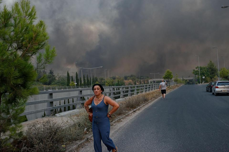 """Forest fire rages in Varybobi, north of Athens, Greece on Aug. 3. Residential areas in Athens northern suburbs were evacuated as wildfires reached the outskirts of the city.<span class=""""copyright"""">Gerasimos Koilakos—NurPhoto/Getty Images</span>"""