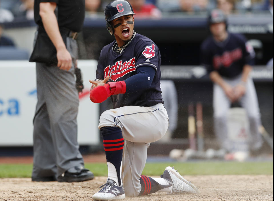 Cleveland Indians' Francisco Lindor reacts after scoring on a Jason Kipnis sacrifice fly during the eighth inning of a baseball game against the New York Yankees in New York, Sunday, May 6, 2018. (AP Photo/Kathy Willens)