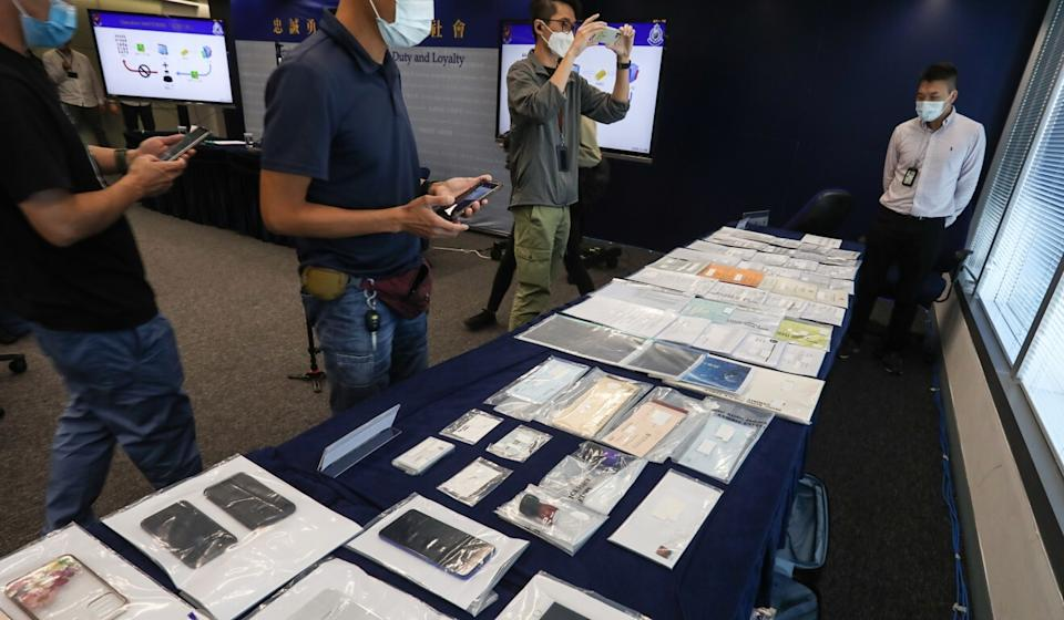 Some of the items seized by officers during the investigation into the scam. Photo: Jonathan Wong