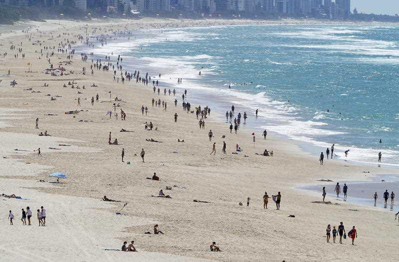 Crowds are seen enjoying beach conditions on the Gold Coast.