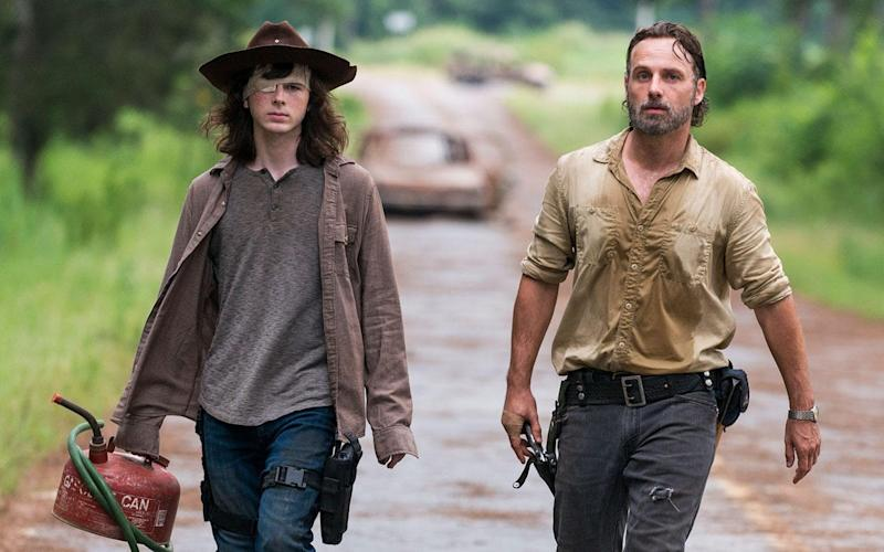 Chandler Riggs and Andrew Lincoln in The Walking Dead - © 2017 AMC Film Holdings LLC. All Rights Reserved.