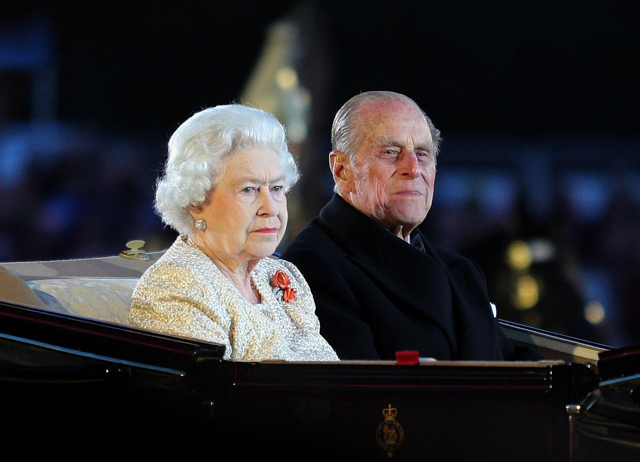 WINDSOR, UNITED KINGDOM - MAY 13:  Queen Elizabeth II and Prince Philip, Duke of Edinburgh arrive at the Diamond Jubilee Pageant in the private grounds of Windsor Castle on May 13, 2012 in Windsor, England. (Photo by Jane Mingay/WPA Pool/Getty Images)