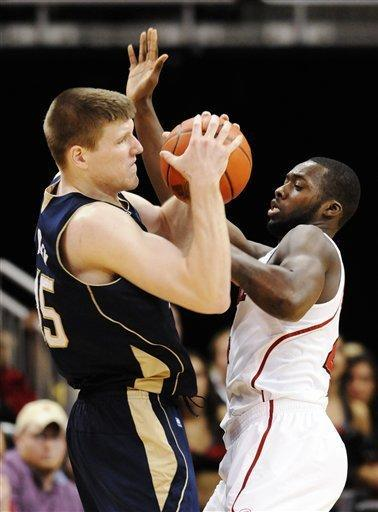 Louisville's Rakeem Buckles, right, battles Notre Dame's Jack Cooley for the ball during overtime of their NCAA college basketball game, Saturday, Jan. 7, 2012, in Louisville, Ky. Notre Dame won 67-65 in double overtime. (AP Photo/Timothy D. Easley)