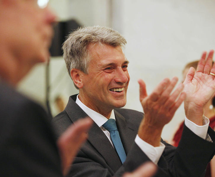 """FILE - In this July 31, 2013 file photo, Minnesota Mayor R.T. Rybak applauds after a performance by the Twin Cities Gay Men's Chorus at the Minneapolis City Hall. Rybak is hitting the road to promote his state's new gay marriage law. He is traveling to Chicago on Thursday, Sept. 5 to launch a """"Marry in Minneapolis"""" campaign in the hopes that Illinois gay and lesbian couples will do just that. Illinois has not passed a gay marriage law, an issue is scheduled to come before state lawmakers again this fall. (AP Photo/Stacy Bengs, File)"""