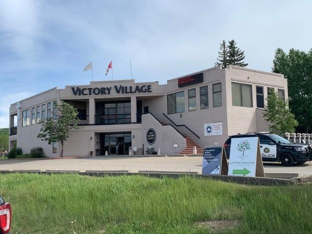 Calgary police responded to a stabbing at Victory Village on Friday afternoon, part of New Victory Church. Two men were sent to hospital in serious condition. (Julie Debeljak/CBC - image credit)