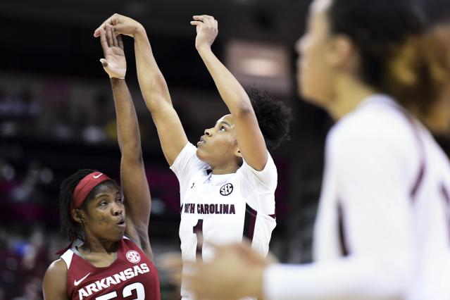 South Carolina guard Zia Cooke , back right, follows through on a shot against Arkansas guard Rokia Doumbia, left, during the first half of an NCAA college basketball game Thursday, Jan. 9, 2020, in Columbia, S.C. (AP Photo/Sean Rayford)