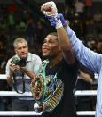 Devin Haney celebrates after defeating Jorge Linares by unanimous decision in the WBC lightweight title boxing match Saturday, May 29, 2021, in Las Vegas. (AP Photo/Chase Stevens)