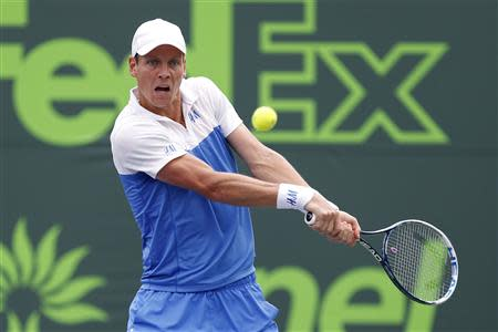 Mar 27, 2014; Miami, FL, USA; Tomas Berdych hits a backhand against Alexandr Dolgopolov (not pictured) on day eleven of the Sony Open at Crandon Tennis Center. BGeoff Burke-USA TODAY Sports