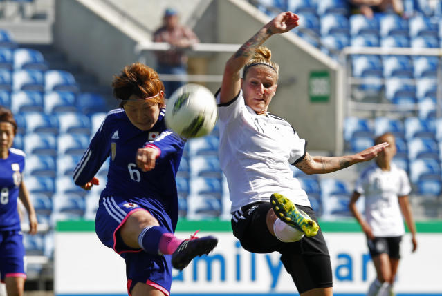 Japan's Sakaguchi Mizuho, left, vies for the ball with Germany's Anja Mittag during the women's soccer Algarve Cup final match between Germany and Japan at the Algarve stadium, outside Faro, southern Portugal, Wednesday, March 12, 2014. (AP Photo/Francisco Seco)