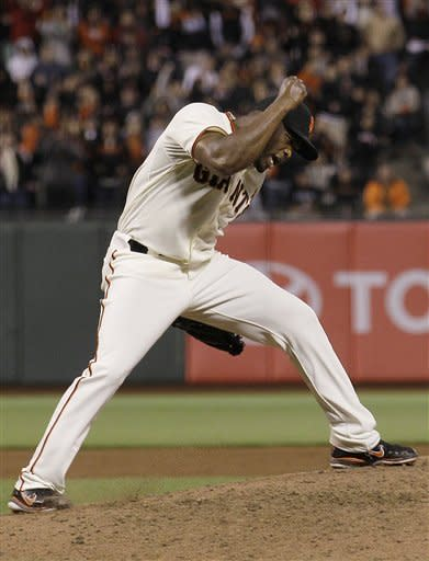 San Francisco Giants pitcher Santiago Casilla celebrates after the final out of the ninth inning of a baseball game against the Colorado Rockies in San Francisco, Monday, May 14, 2012. The Giants won 3-2. (AP Photo/Jeff Chiu)