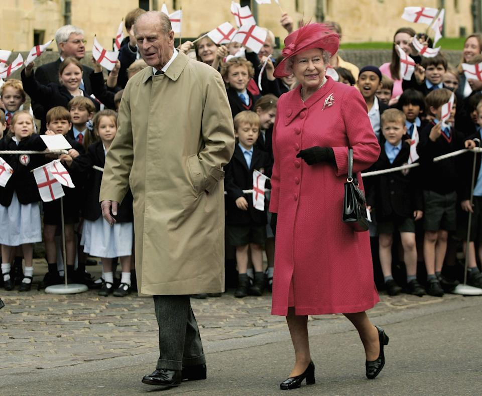 WINDSOR, UNITED KINGDOM - APRIL 21:  Queen Elizabeth II and Prince Philip, Duke of Edinburgh meet with well wishers on April 21, 2006 in Windsor, England. HRH Queen Elizabeth II is taking part in her traditional walk in the town to celebrate her 80th Birthday. In the evening the Prince of Wales will host a private party for The Queen and other members of the Royal family at Kew Palace.(Photo by Daniel Berehulak/Getty Images)