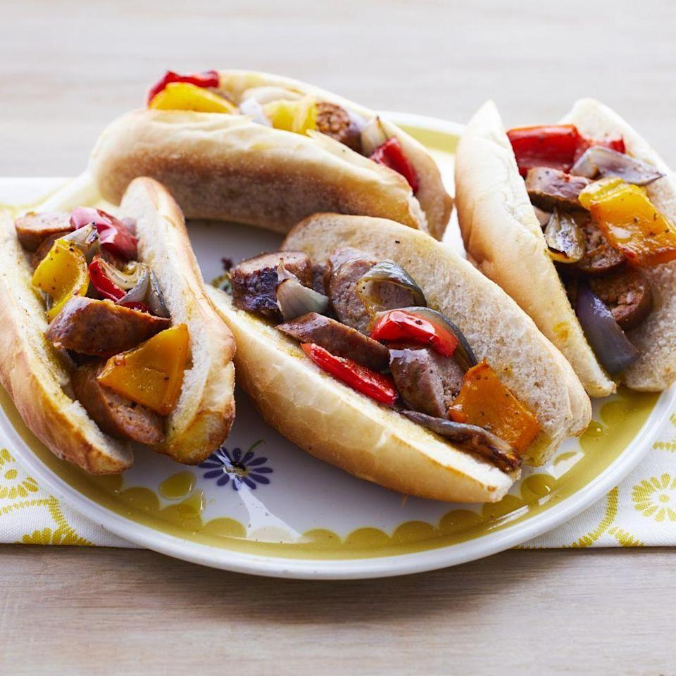 """<p>Add these filling sausage and pepper grinders to your weeknight meal routine. The sheet pan method will save you tons of time!</p><p><strong><a href=""""https://www.thepioneerwoman.com/food-cooking/recipes/a32380541/sheet-pan-sausage-and-pepper-hoagies-recipe/"""" rel=""""nofollow noopener"""" target=""""_blank"""" data-ylk=""""slk:Get the recipe."""" class=""""link rapid-noclick-resp"""">Get the recipe.</a></strong> </p>"""