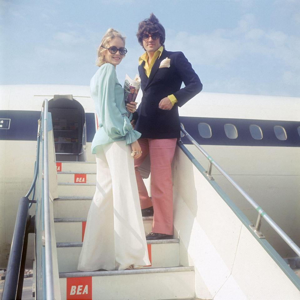 <p>British fashion model Twiggy and her partner and manager Justin de Villeneuve board an airplane for a holiday in Greece.</p><p> Other celebrity visitors this year: Jackie Kennedy.</p>