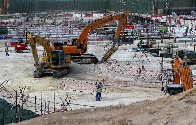 Foreign labourers work at the construction site of the al-Wakrah football stadium, one of Qatar's 2022 World Cup stadiums, on May 4, 2015, in Doha's southern suburbs (AFP Photo/Marwan Naamani)