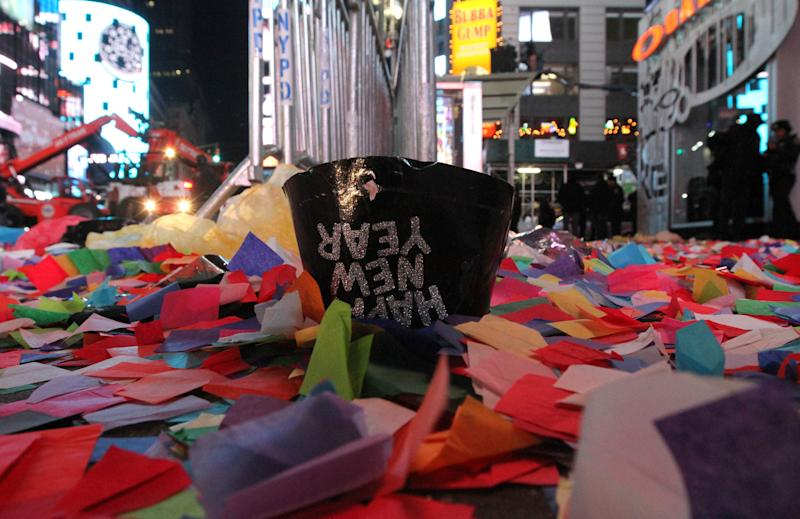 Confetti and other debris are seen in New York's Times Square early New Year's Day Wednesday Jan. 1, 2014. (AP Photo/Tina Fineberg)