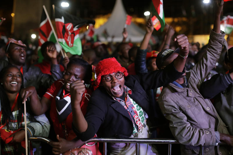 Supporters of Kenya's President Uhuru Kenyatta cheer as they hear the election results, at the Kenya International Conference Center in downtown Nairobi, Kenya, Friday, Aug. 11, 2017. Kenya's election commission announced Friday that President Uhuru Kenyatta has won a second term as opposition candidate Raila Odinga claimed the vote was rigged. (AP Photo/Ben Curtis)