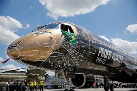 FILE PHOTO: An Embraer E195-2 is seen on display, sporting a livery combining a lion's head with an integrated circuit design, during the 53rd International Paris Air Show at Le Bourget Airport near Paris