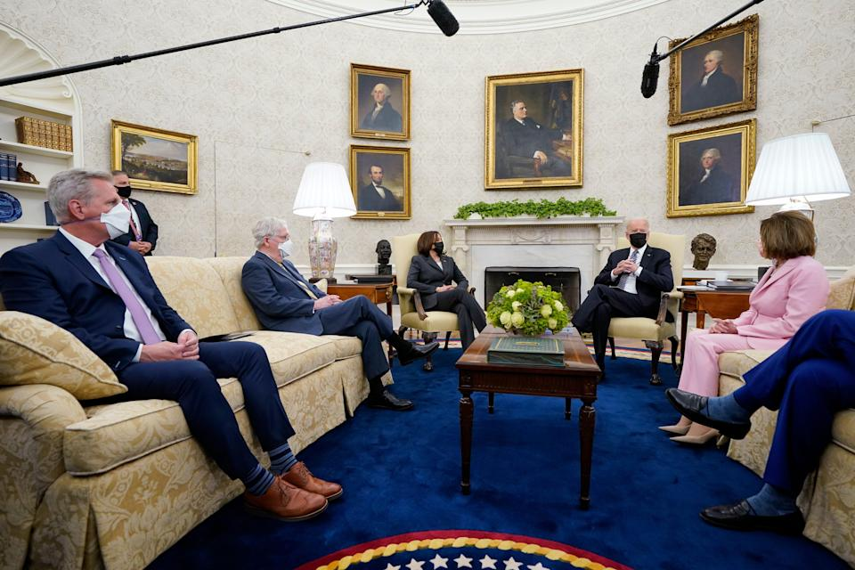 President Joe Biden and Vice President Kamala Harris meet on May 12 with congressional leaders, from left, House Minority Leader Kevin McCarthy, R-Calif.; Senate Minority Leader Mitch McConnell, R-Ky.; House Speaker Nancy Pelosi, D-Calif.; and Senate Majority Leader Chuck Schumer, D-N.Y.