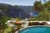 """<p>Perched on top of a cliff on Ibiza's rugged north coast, <a href=""""https://www.booking.com/hotel/es/hacienda-na-xamena.en-gb.html?aid=2070929&label=ibiza-hotels"""" rel=""""nofollow noopener"""" target=""""_blank"""" data-ylk=""""slk:Hacienda Na Xamena"""" class=""""link rapid-noclick-resp"""">Hacienda Na Xamena</a> is the first five-star hotel to open on the White Isle and is still at the top of its game. Every one of the 78 rooms has private outdoor space and magnificent views overlooking San Miguel Bay. </p><p>However, nothing can beat watching the sun set from one of the cascading pools built into the side of the rock. There's also a modern spa and a brace of restaurants, one serving poolside breakfasts and deliciously Mediterranean lunches, while Edén is a rather special spot scattered with tiny enclaves, perfect for a romantic rendezvous.</p><p><a class=""""link rapid-noclick-resp"""" href=""""https://www.booking.com/hotel/es/hacienda-na-xamena.en-gb.html?aid=2070929&label=ibiza-hotels"""" rel=""""nofollow noopener"""" target=""""_blank"""" data-ylk=""""slk:CHECK AVAILABILITY"""">CHECK AVAILABILITY</a></p>"""