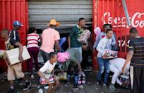 Looters stole items from shops they believed to be foreign-owned during a riot in a Johannesburg suburb