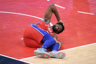 Philadelphia 76ers center Joel Embiid (21) reacts after an injury during the second half of the team's NBA basketball game against the Washington Wizards, Friday, March 12, 2021, in Washington. (AP Photo/Nick Wass)