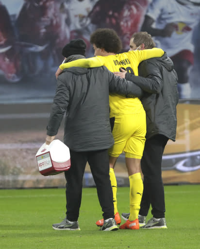 Dortmund's Axel Witsel leaves the pitch after being injured during the German Bundesliga soccer match between RB Leipzig and Borussia Dortmund in Leipzig, Germany, Saturday, Jan. 9, 2021. (AP Photo/Michael Sohn)