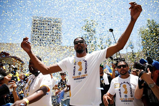 Jun 12, 2018; Oakland, CA, USA; Golden State Warriors forward Kevin Durant interacts with fans during the Warriors 2018 championship victory parade in downtown Oakland. Mandatory Credit: Cary Edmondson-USA TODAY Sports TPX IMAGES OF THE DAY