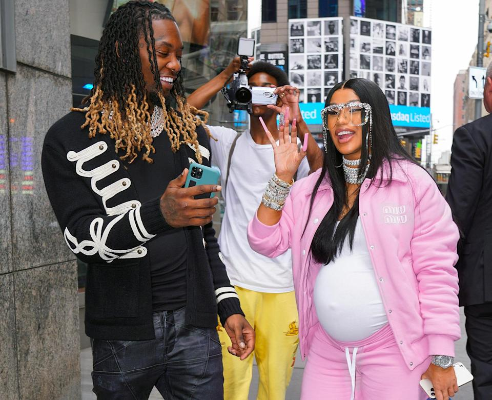 <p>Offset and Cardi B greet fans at NASDAQ headquarters in New York City's Times Square to ring the bell for Reservoir Media's IPO on Aug. 30.</p>