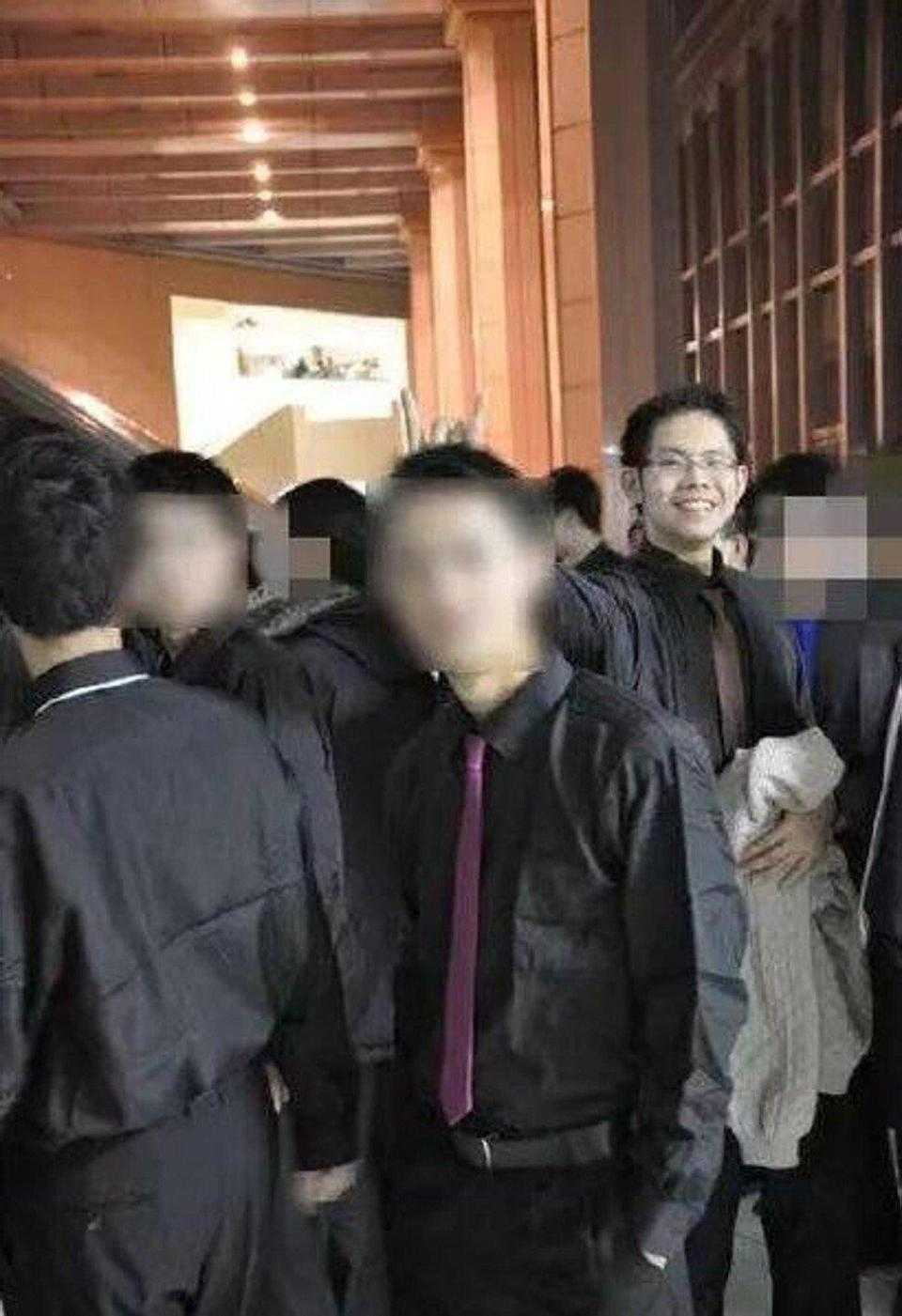 """A picture of Wu Xieyu smiling and giving somebody the """"bunny ears"""". Photo: Handout"""