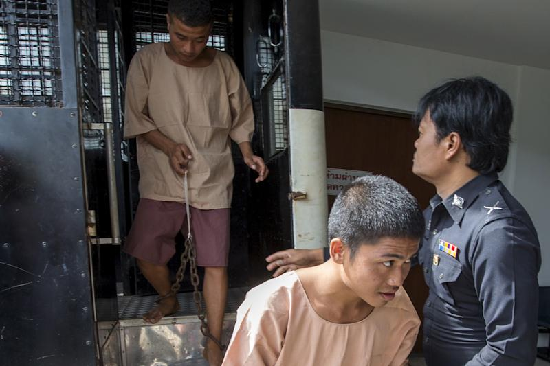 Myanmar migrant workers Zaw Lin (C) and Wai Phyo (L), also known as Win Zaw Htun, arrive at the Koh Samui Provincial Court, in Koh Samui, Thailand, July 8, 2015. The two men are on trial for the murder of Hannah Witheridge, 23, and David Miller, 24, in September last year on a beach on Koh Tao, an island popular with backpackers and divers. REUTERS/Athit Perawongmetha/Files