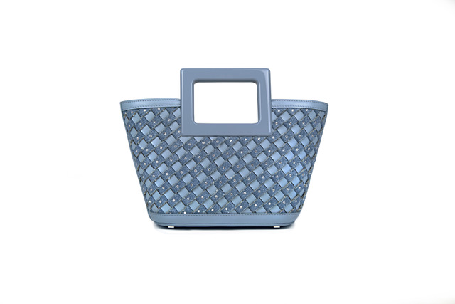 """<p>Marina Raphael is donating 20 per cent of proceeds from sales of this beautiful woven bag to Women for Women International throughout the month of March, helping women survivors of war rebuild their lives and choose their own futures.</p><p><a class=""""link rapid-noclick-resp"""" href=""""https://marinaraphael.com"""" rel=""""nofollow noopener"""" target=""""_blank"""" data-ylk=""""slk:SHOP HERE"""">SHOP HERE</a></p>"""
