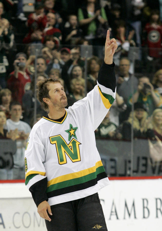 FILE - In this April 10, 2010, file photo, Dallas Stars center Mike Modano acknowledges the crowd after skating on to the ice in his Minnesota North Stars jersey after the Dallas Stars defeated the Minnesota Wild 4-3 in a shootout in an NHL hockey game in St. Paul, Minn. The Hall of Fame center was named executive adviser to Minnesota Wild owner Craig Leipold and president Matt Majka on Thursday, May 23, 2019. (AP Photo/Andy King, File)