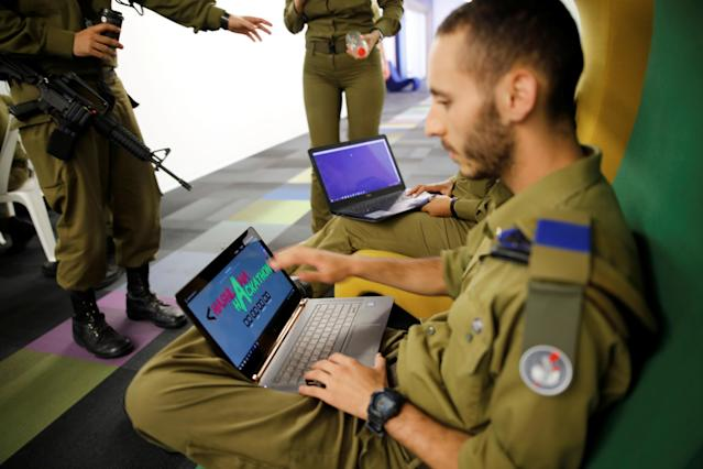 Israeli soldiers work on laptops as they take part in a cyber security training course, called a Hackathon, at iNT Institute of Technology and Innovation, at a high-tech park in Beersheba, southern Israel August 28, 2017. Picture taken August 28, 2017.