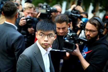 Hong Kong's pro-democracy activist Joshua Wong speaks with the media after a news conference in Berlin