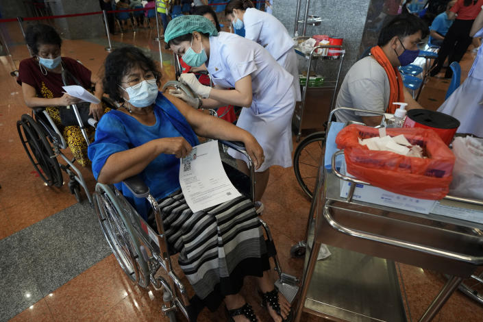 A health worker administers a dose of the Sinopharm COVID-19 vaccine to a disabled person in Bangkok, Thailand, Friday, June 25, 2021. (AP Photo/Sakchai Lalit)