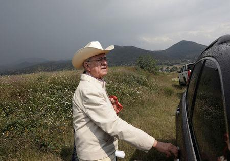 FILE PHOTO: Incoming Minister of Communications and Transportation Javier Jimenez Espriu tours areas affected by the construction of new Mexico City international airport