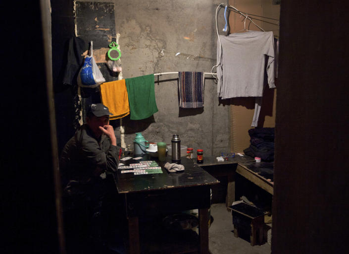 In this July 10, 2012 photo, a Chinese worker looks as he taking a break at a room inside a construction building site in downtown Ulan Bator, Mongolia. In the world's rush to get rich off China, Mongolia works mightily to ensure that Chinese investment does not become Chinese dominance. (AP Photo/Andy Wong)
