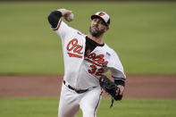 Baltimore Orioles starting pitcher Matt Harvey throws a pitch to the Minnesota Twins during the first inning of a baseball game, Wednesday, June 2, 2021, in Baltimore. (AP Photo/Julio Cortez)