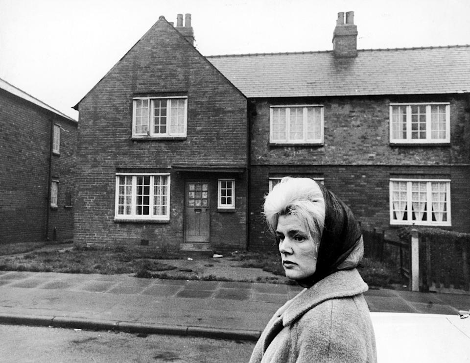 The first big winner on the Football Pools, Viv Nicholson, returns to the street where she lived before striking it rich. Her 38-shilling-a-week council house is behind her.  (Photo by S&G/PA Images via Getty Images)