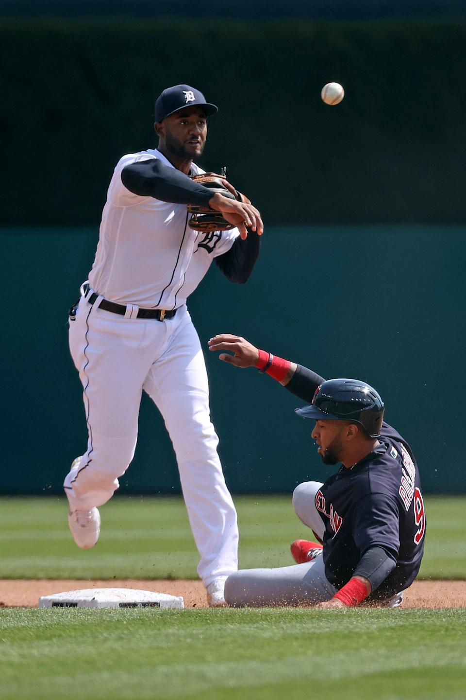 Detroit Tigers' Niko Goodrum turns a fourth-inning double play over the slide of Cleveland Indians' Eddie Rosario at Comerica Park on April 3, 2021.