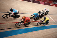 Kelsey Mitchell of Team Canada (105) and Liubov Basova of Team Ukraine (228) compete during the track cycling women keirin at the 2020 Summer Olympics, Thursday, Aug. 5, 2021, in Izu, Japan. (AP Photo/Thibault Camus)