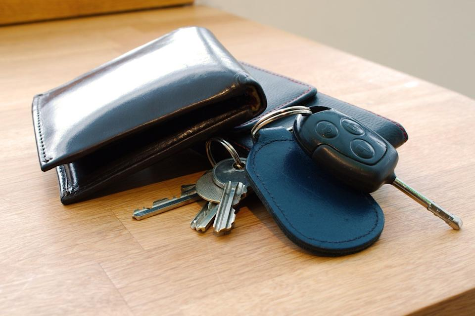 wallet and car keys on table
