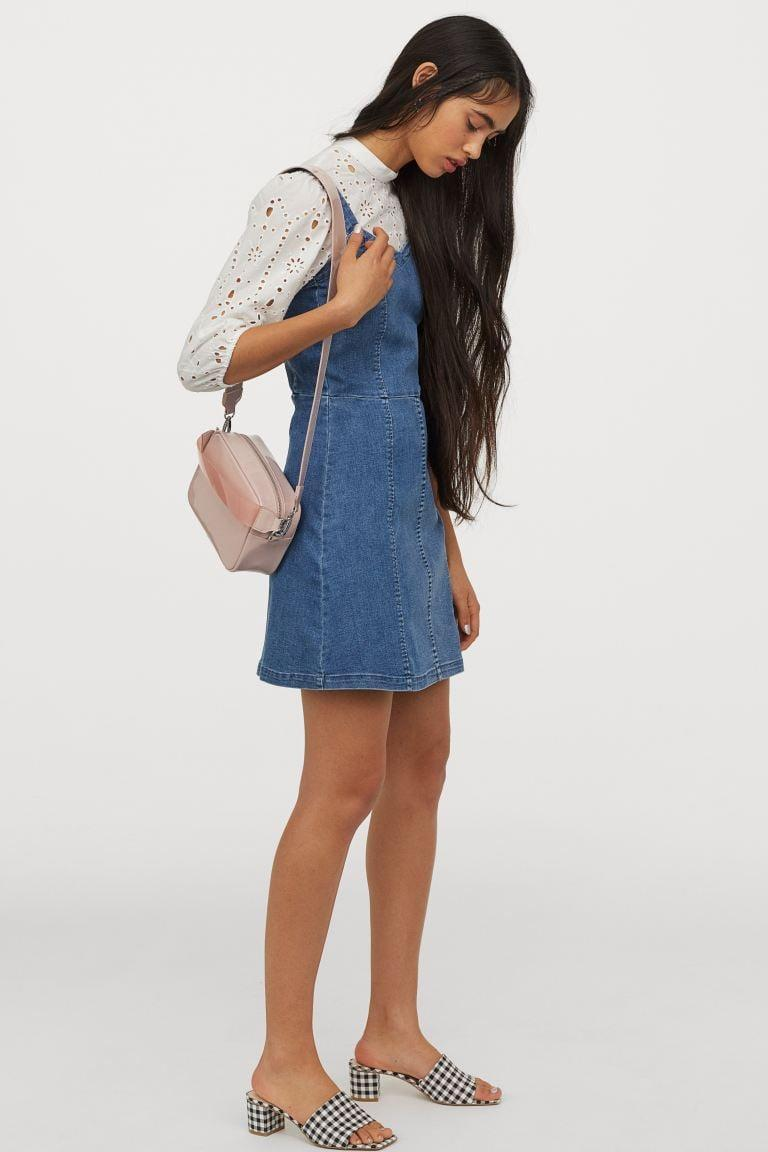 "<p>Layer this <a href=""https://www.popsugar.com/buy/HampM-Denim-Dress-581991?p_name=H%26amp%3BM%20Denim%20Dress&retailer=www2.hm.com&pid=581991&price=28&evar1=fab%3Aus&evar9=35329485&evar98=https%3A%2F%2Fwww.popsugar.com%2Ffashion%2Fphoto-gallery%2F35329485%2Fimage%2F47550196%2FHM-Denim-Dress&list1=shopping%2Cdenim%2Csummer%20fashion%2Cfashion%20shopping&prop13=mobile&pdata=1"" class=""link rapid-noclick-resp"" rel=""nofollow noopener"" target=""_blank"" data-ylk=""slk:H&amp;M Denim Dress"">H&amp;M Denim Dress</a> ($28, originally $35) with a cute top.</p>"