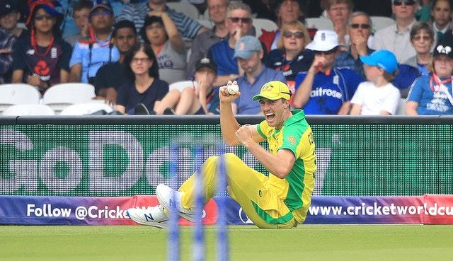 Australia's Pat Cummins celebrates taking the catch to dismiss Eoin Morgan