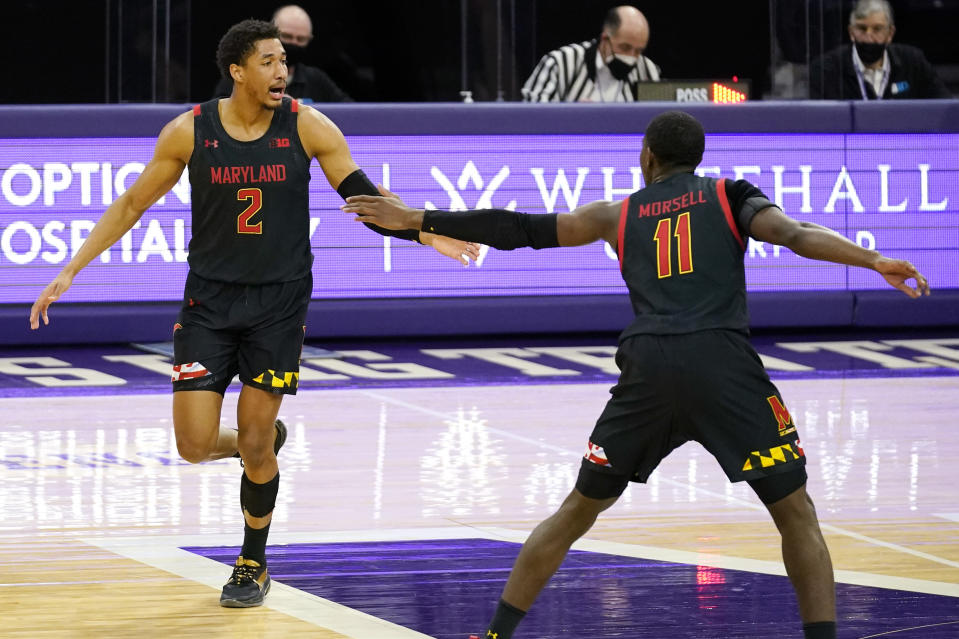 Maryland guard Aaron Wiggins, left, celebrates with guard Darryl Morsell after making a three-point basket against Northwestern during the second half of an NCAA college basketball game in Evanston, Ill., Wednesday, March 3, 2021. Northwestern won 60-55.(AP Photo/Nam Y. Huh)